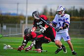 Boys Lacrosse players going down