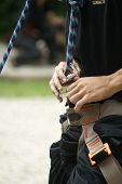 Climber clipping carabiner into harness