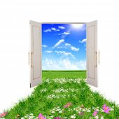 picture of open door  - open door leading to beautiful clean nature with green grass and blue sky - JPG