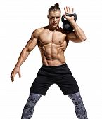 Muscular Man Training With Kettlebell. Photo Of Handsome Man With Naked Torso And Good Physique On W poster