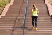 Full Length Rear View Of An Active And Determined Middle-aged Woman Running While Climbing Stairs Du poster