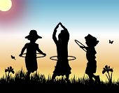 image of hula hoop  - silhouettes of three girls playing hula hoops on sunset background - JPG