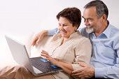 picture of elderly couple  - Senior couple on laptop - JPG