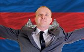 Happy Businessman Because Of Profitable Investment In Cambodia Standing Near Flag