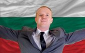 Happy Businessman Because Of Profitable Investment In Bulgaria Standing Near Flag