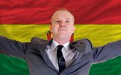 Happy Businessman Because Of Profitable Investment In Bolivia Standing Near Flag