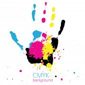 Hand with CMYK ink splashes
