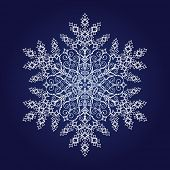 Large detailed snowflake on dark blue background