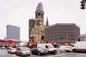 Постер, плакат: Kaiser Wilhelm Memorial Church In Winter Berlin Germany Advent Fair Decoration And Stalls With Cra