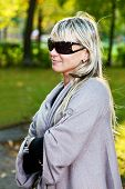 Blonde Young Woman With Sunglasses At Park
