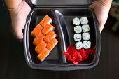 Fresh Sushi On Black Plate, Woman Holding Container With Sushi, Sushi Delivery, Asian Food poster