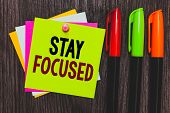Conceptual Hand Writing Showing Stay Focused. Business Photo Showcasing Be Attentive Concentrate Pri poster