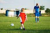 Little Soccer Boy In Red And Trainer In Blue Soccer Dress Are Playing Soccer On Playing Field, Socce poster