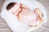 Cute Caucasian Newborn Infant Baby Girl Asleep. Pink Flower Band On Her Head And Pink Plaid. Adorabl poster