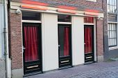 Red Light District In Amsterdam. Windows And Doors Where Prostitutes Work poster