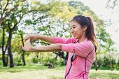 Close Up Of A Young Woman Warm Up Her Body By Stretching Her Arms To Be Ready For Exercising And Do  poster