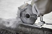 Close Up Of A Circular Saw Cutting A Concrete Slab poster