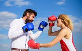 Man And Woman Fight Boxing Gloves Blue Sky Background. Defend Your Opinion In Confrontation. Couple  poster