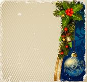 aged  Christmas postcard with a branch of evergreen