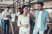 Group Of Young Business People Walking Together. Portrait Of Casualy Dressed Happy Man And Womantalk poster