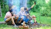 Tourists Sit Log Near Bonfire Taking Photo On Smartphone. Friends On Vacation Capture Moment. Man Ta poster