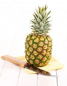 Pineapple on white wooden table