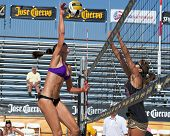 HERMOSA BEACH, CA - JULY 21: -Ashley Lee and Jenny Kropp compete in the Jose Cuervo Pro Beach Volley