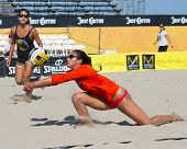HERMOSA BEACH, CA - JULY 21: Lane Carico and Ashley Lee compete in the Jose Cuervo Pro Beach Volleyb