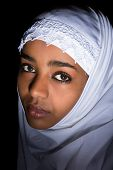 Melancholic Ethiopian girl wearing an islamic white veil