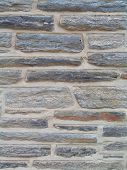 picture of fieldstone-wall  - vertical shot of stone wall made with mica stone in tones of gray and white - JPG
