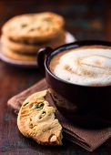 Cafe au lait and pistachio cookie