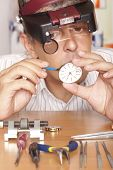 Watch repair craftsman repairing watch Focus on watch