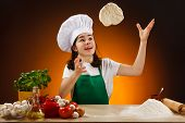 Girl making pizza dough