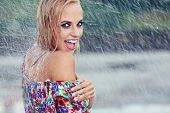 portrait of young beautiful woman in rain
