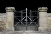 stock photo of wrought iron  - entrance of a graveyard with a closed wrought - JPG