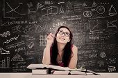 stock photo of nerd glasses  - College female student is learning in the classroom - JPG