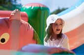 Cute Little Girl In A Jumping Castle