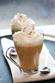 stock photo of hot-chocolate  - coffee latte macchiato with cream in glasses shallow DOF - JPG