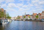 Spaarne river with boats in old Haarlem, Holland