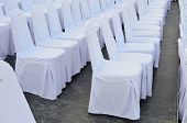 stock photo of grandstand  - Chairs in row cover with white, set up for wedding day.