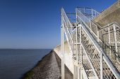 Steps Over The Sea Wall On Canvey Island, Essex, England