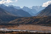 Snow Capped Peaks In Fall