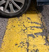 stock photo of hump  - Speed bump with yellow hump and care tire - JPG