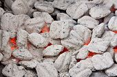 image of briquette  - Hot coals and briquettes glowing in open fire pit - JPG
