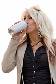 pic of chug  - A young woman drinking from an aluminum can with a blank label - JPG