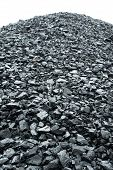 stock photo of combustion  - Combustion coal pile in an industrial area - JPG