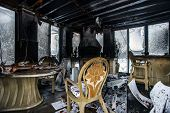 stock photo of accident emergency  - Fire damaged interior details in summer house after blaze - JPG