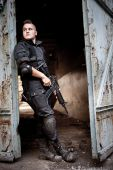 foto of m4  - Brave sentinel with M4 carbine near the rusty gates - JPG