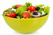 Greek salad on plate isolated on white