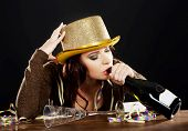foto of bolero  - Drunk young woman celebrating new years eve - JPG
